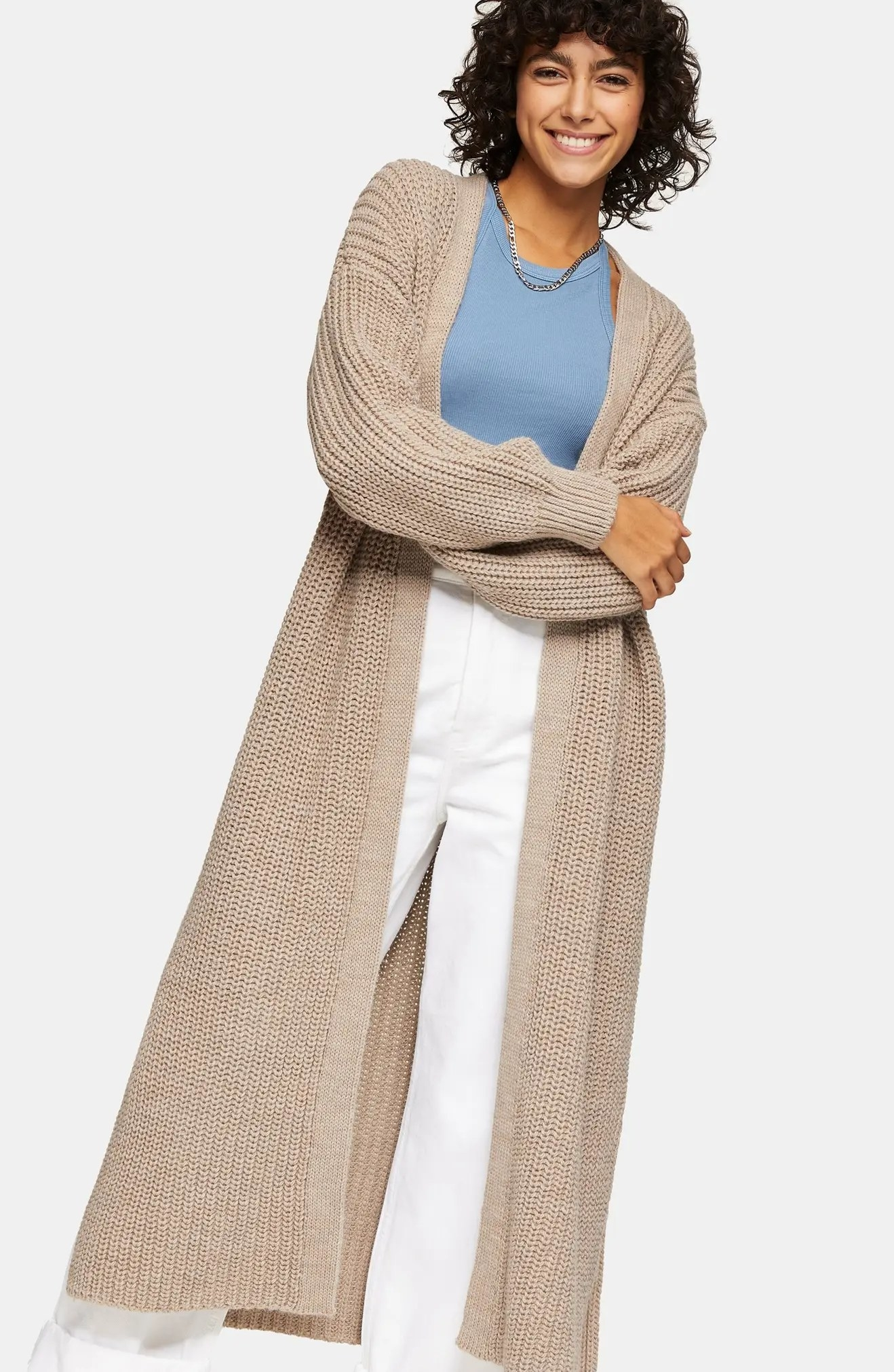 The cardigan worn by a smiling model