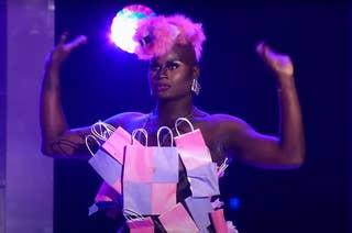 La La ri wearing her infamous bag outfit