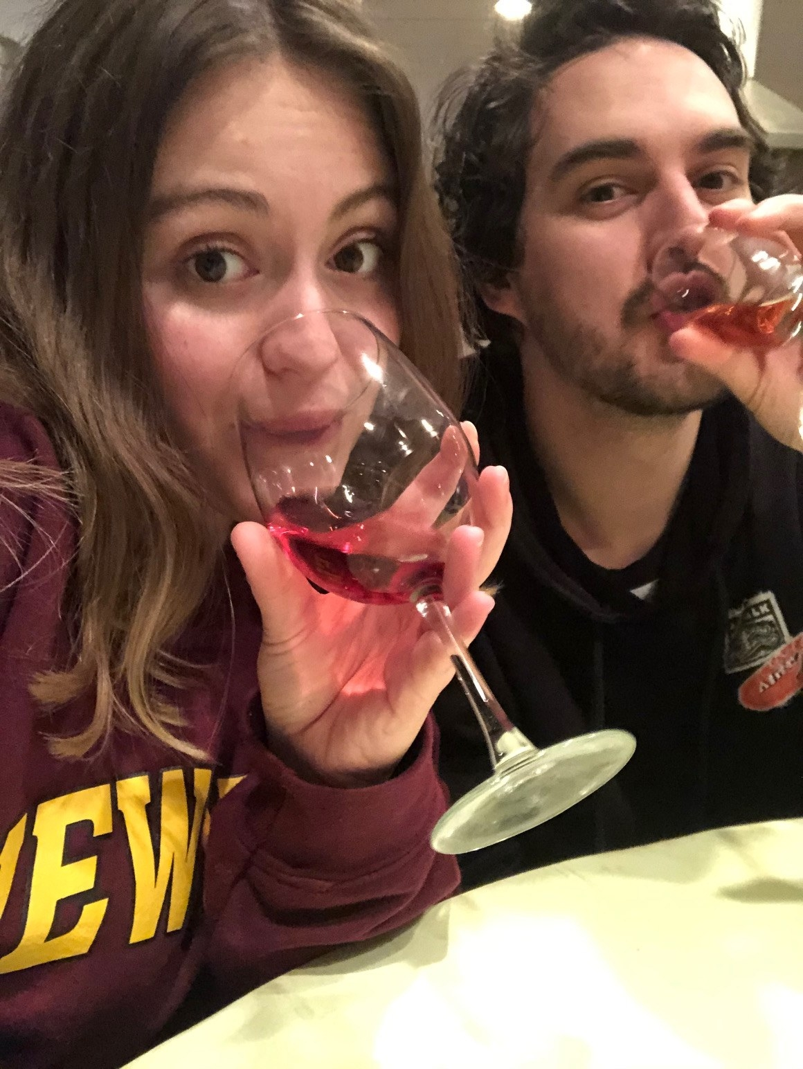 Woman and man sipping wine