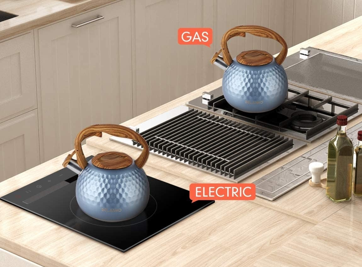 Two royal blue kettles with induction diamond designs and wood-colored handles