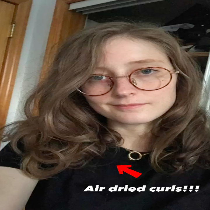 me with big loose curls with the caption air dried curls