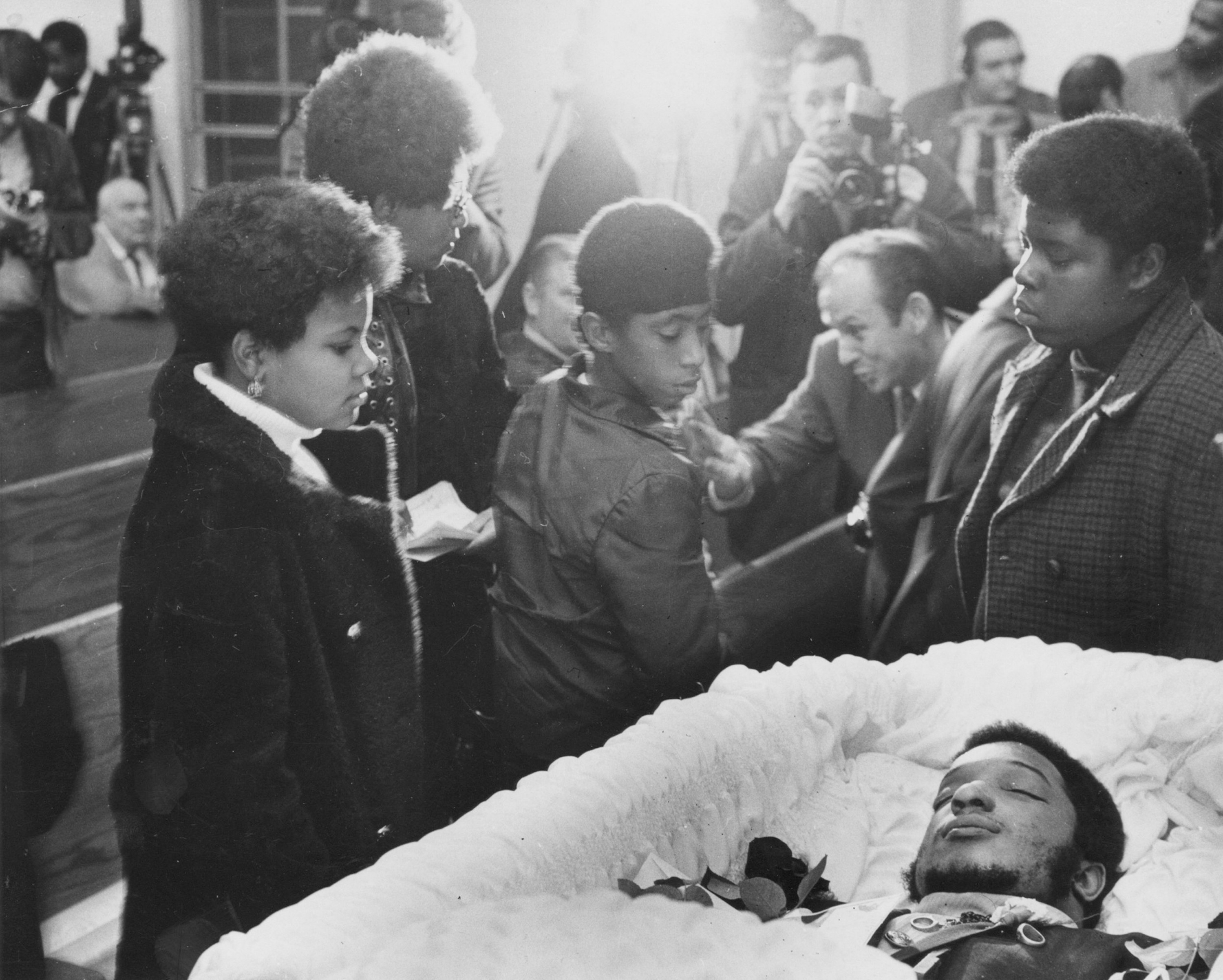 People view the open casket of Fred Hampton.