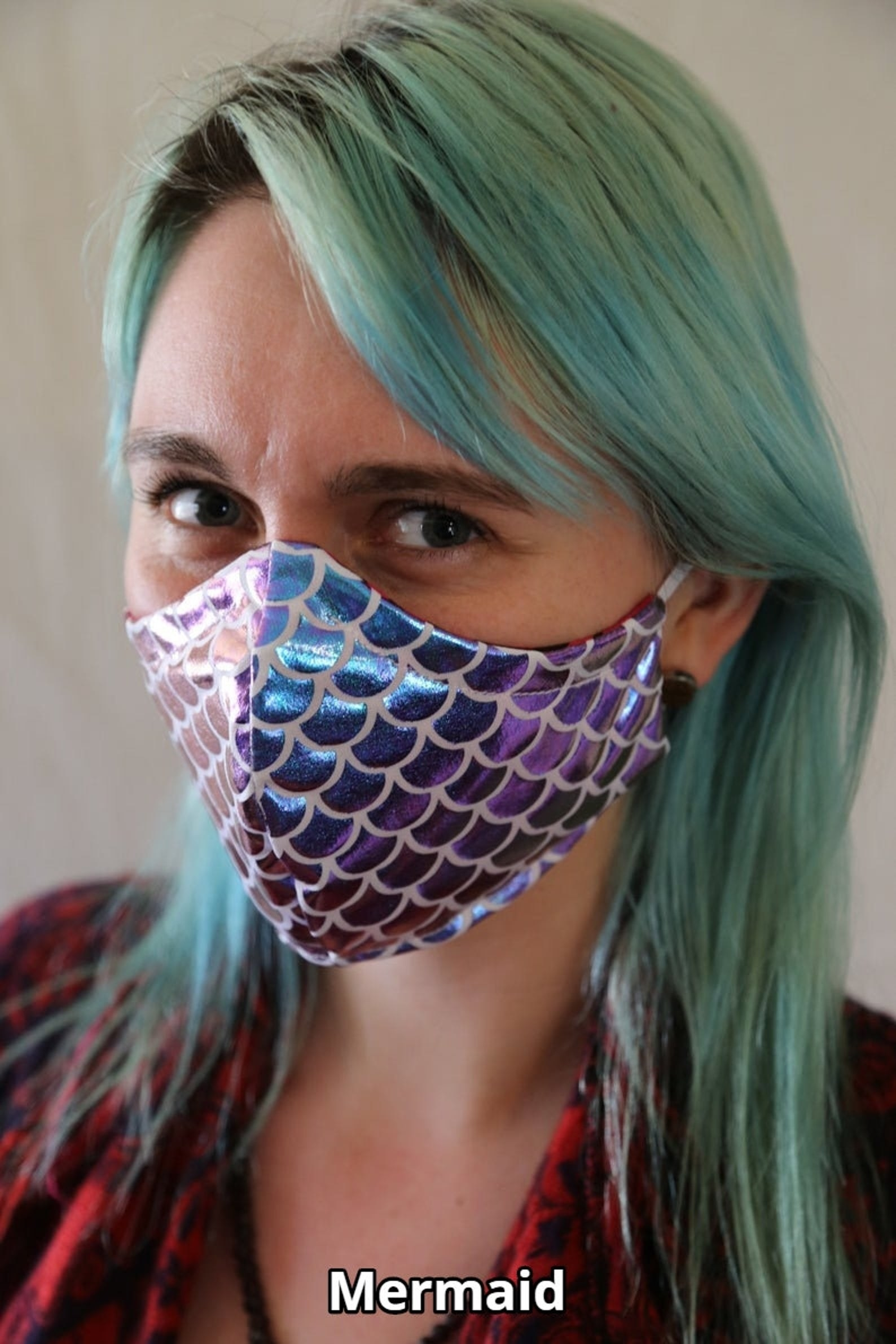 Model wearing a shimmering face mask