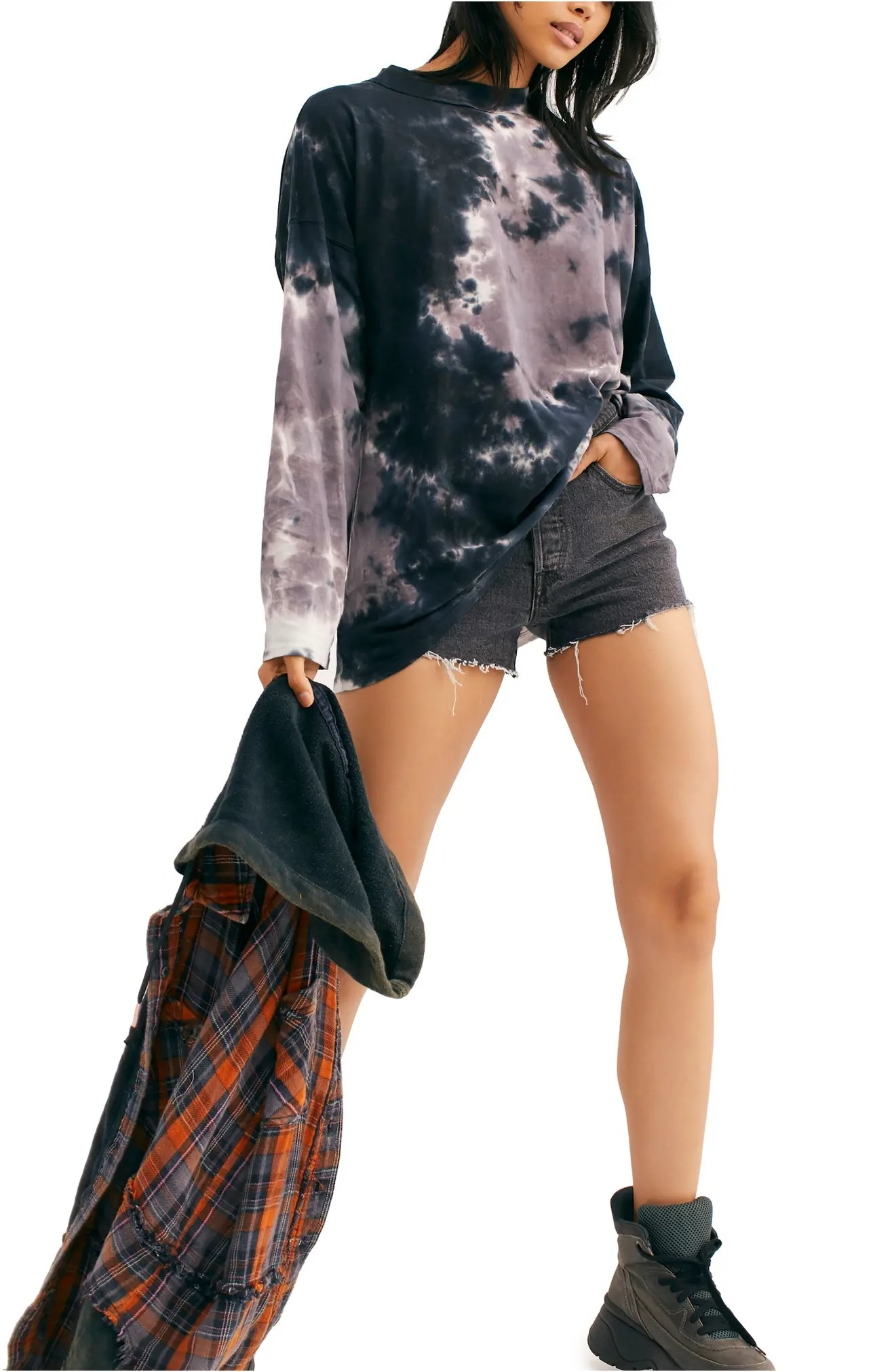 The shirt paired with frayed denim shorts