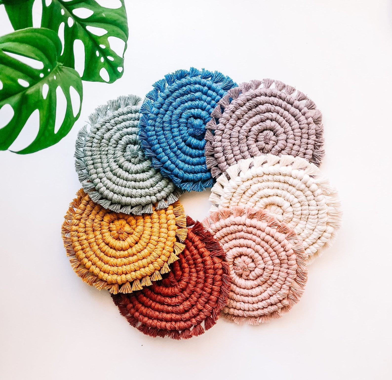 the coasters in  neutral, pink, orange, mustard, sage, blue, and lavender