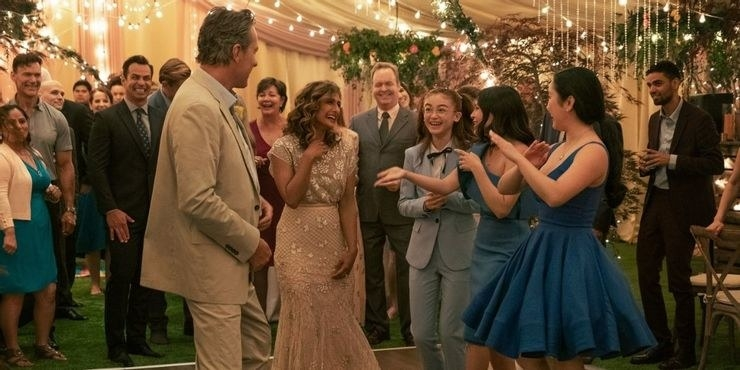 Dr, Covey, Trina, Lara, and family dance together