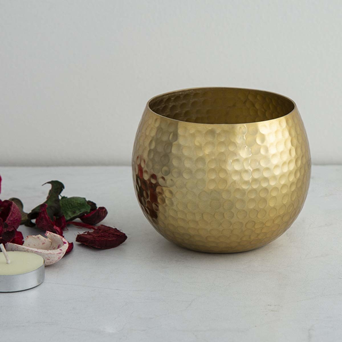 A golden tealight holder