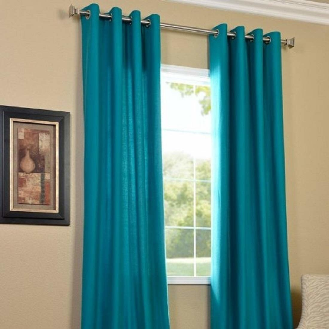Two aqua curtains on a window