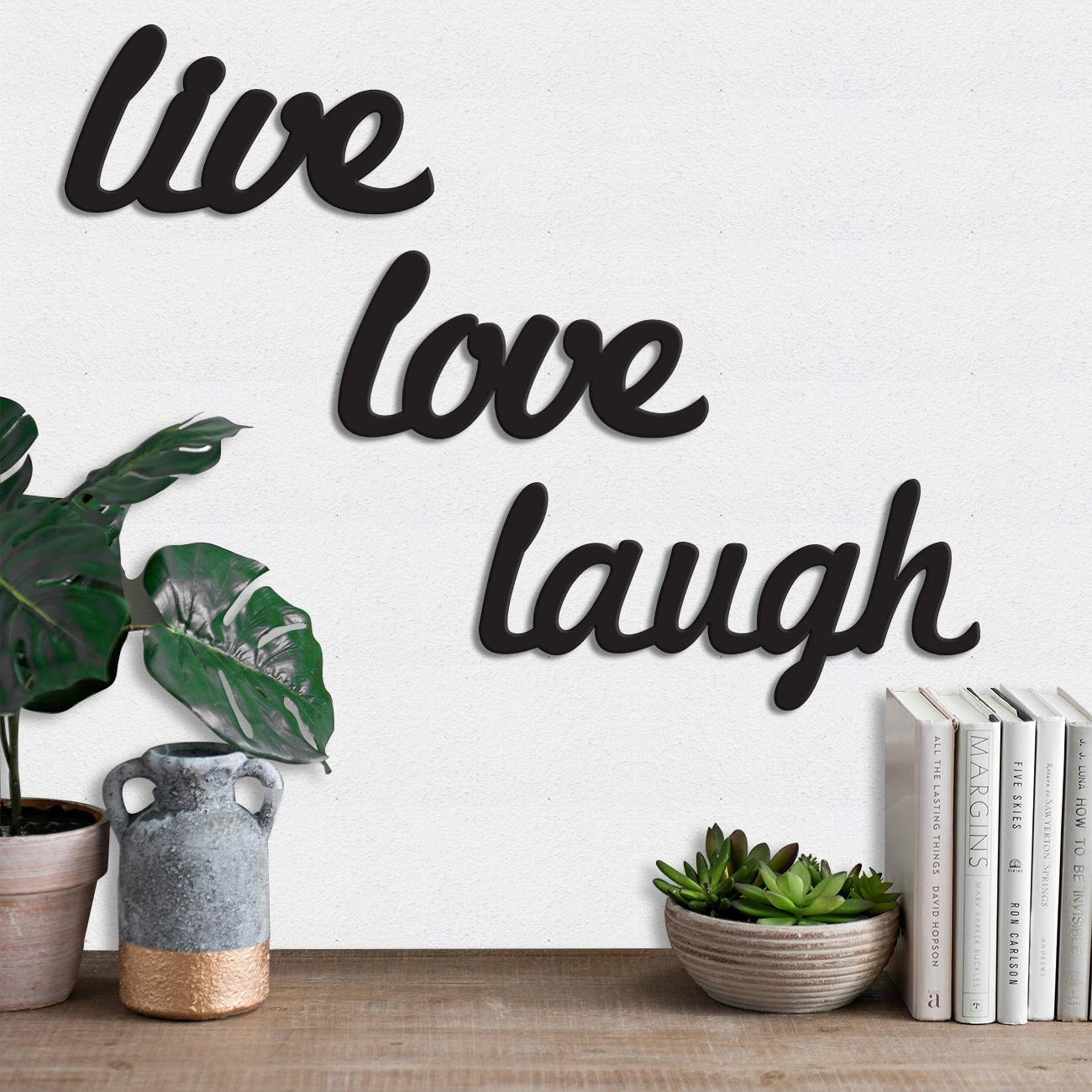 A wall plaque that says Live Love Laugh