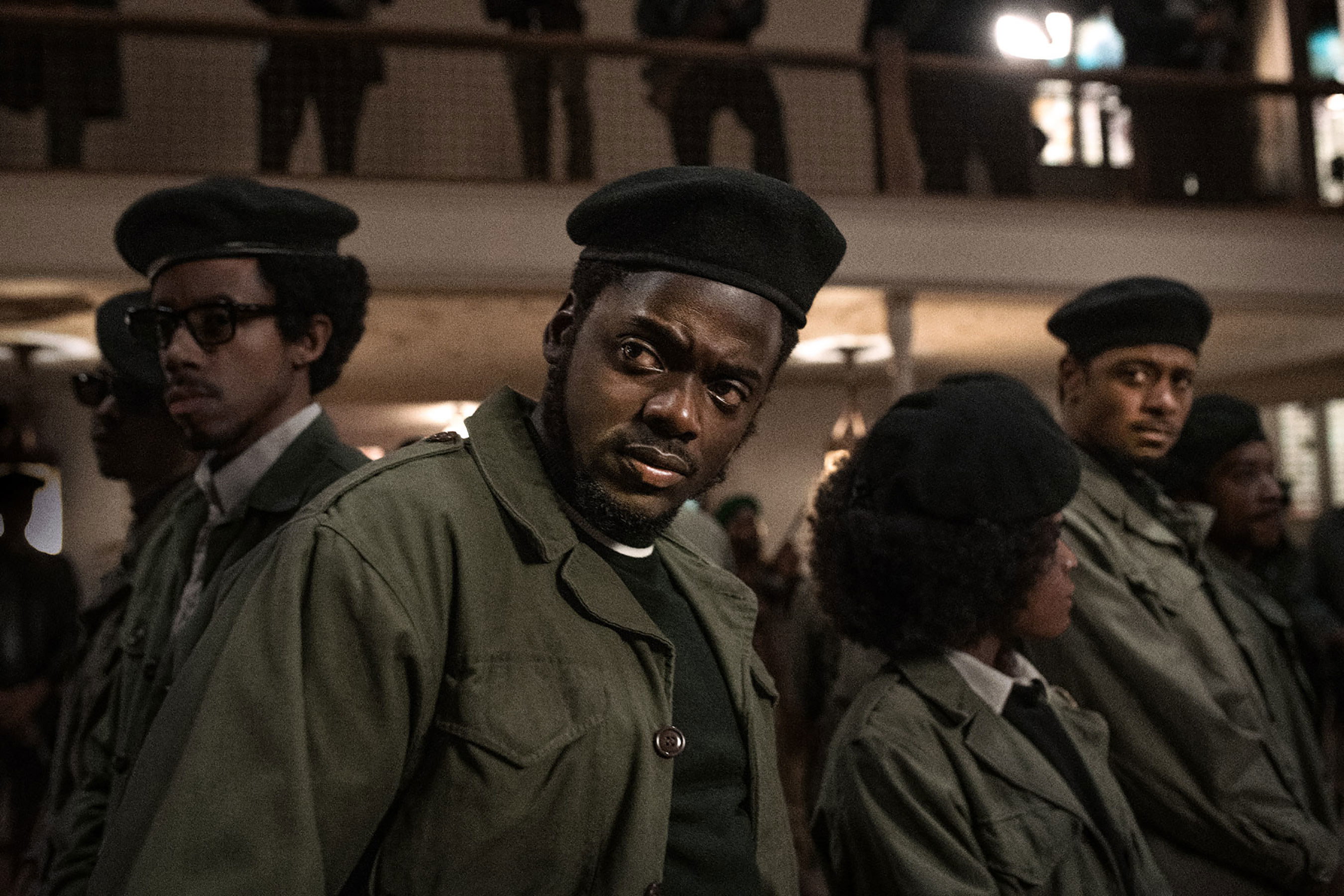 Fred Hampton is looking defensively with his comrades