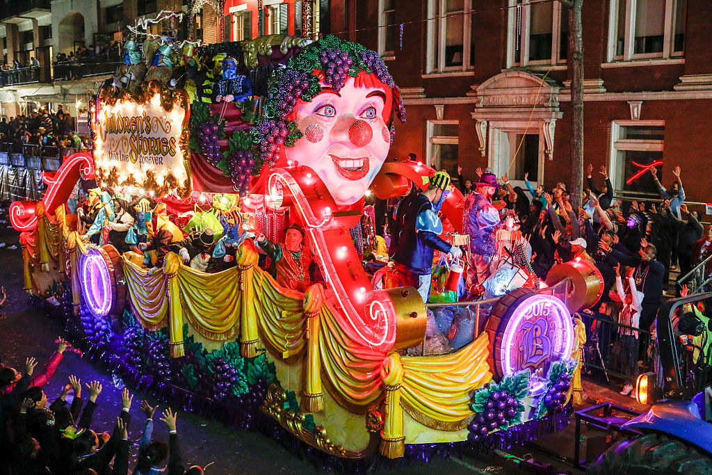 a  float with the theme 'Children's Stories That Live Forever' in the Krewe of Bacchus parade during Mardi Gras