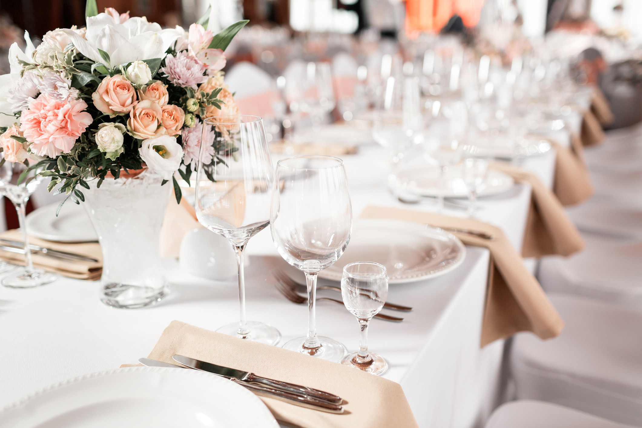 Tables set for an event party or wedding reception luxury elegant table setting dinner in a restaurant with glasses and dishes