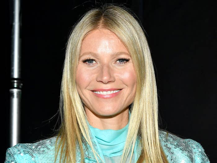 Gwyneth smiles at a red carpet event