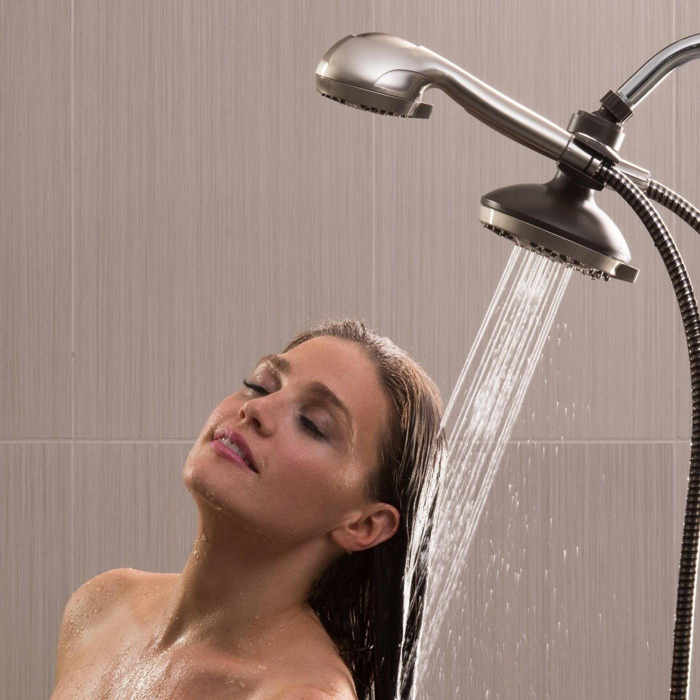 A person showering with the rainfall head on