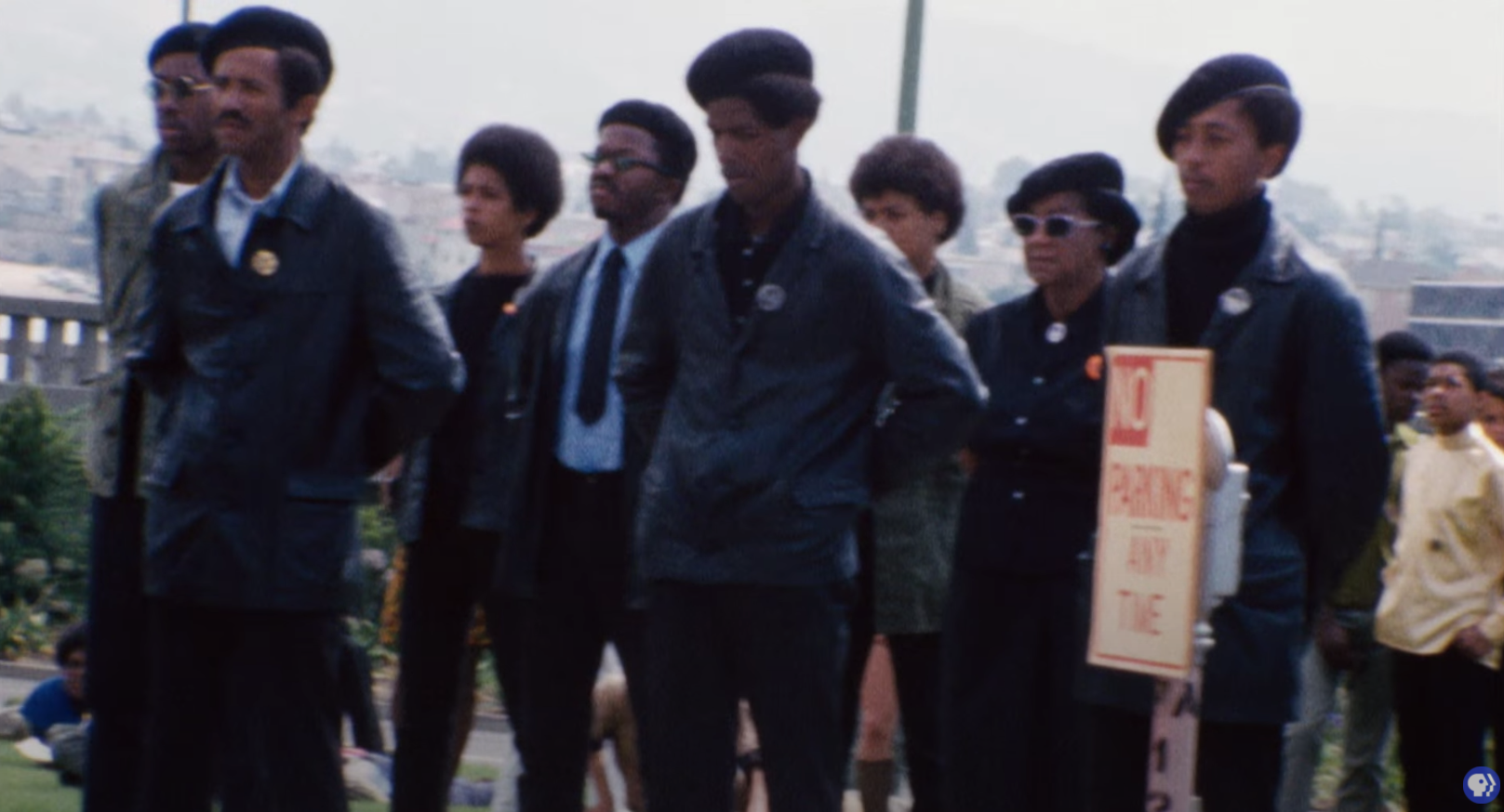 Archival footage of the Black Panther Party wearing leather jackets, berets, sunglasses, and powder blue shirts