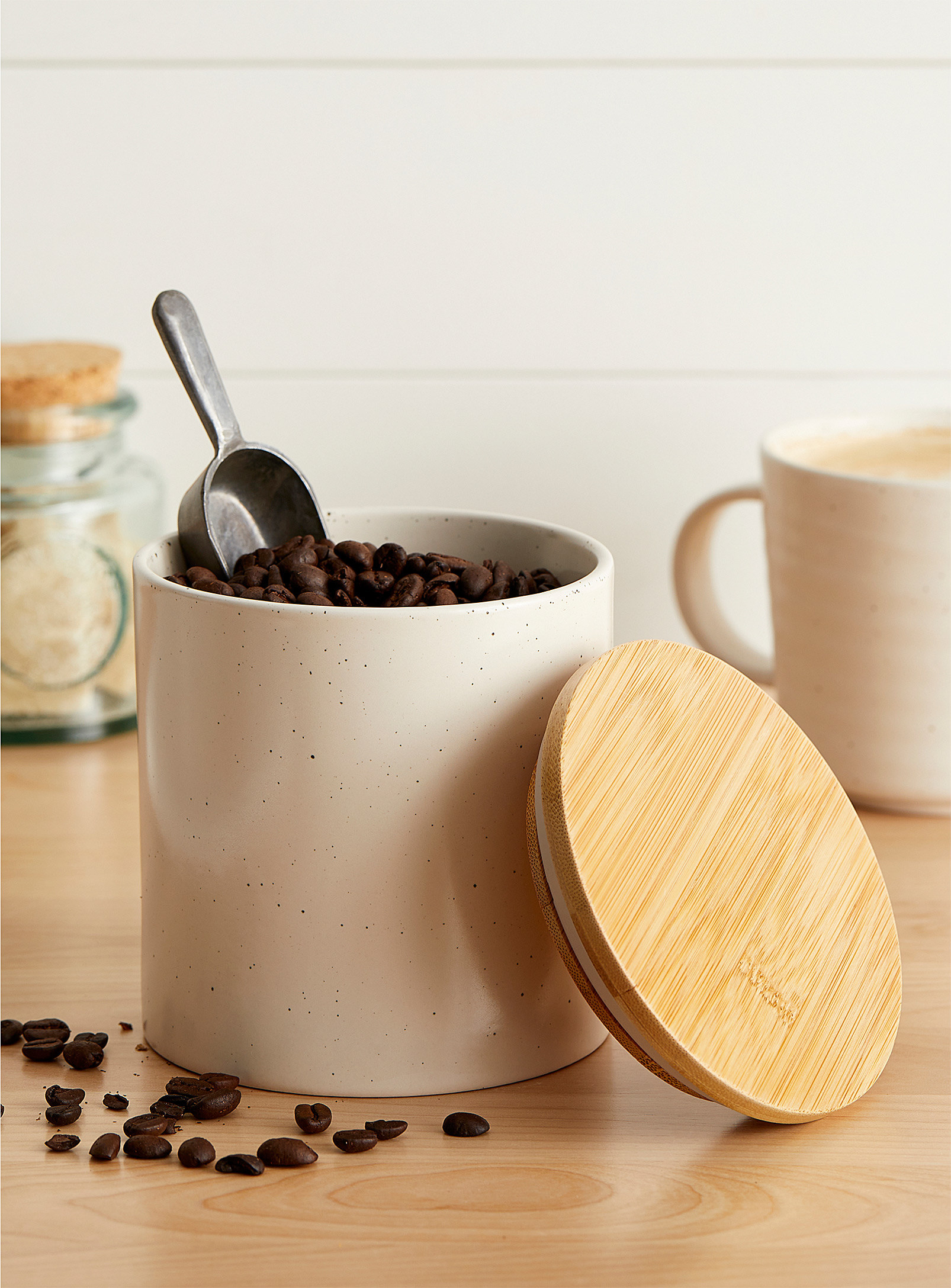 A ceramic jar filled with coffee beans
