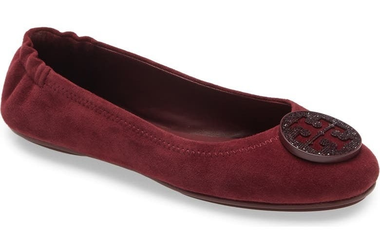 burgundy tory burch flat shoes with an elastic back