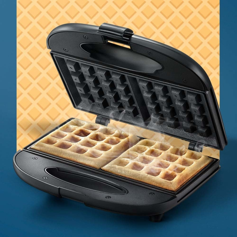 A waffle maker with waffles being cooked