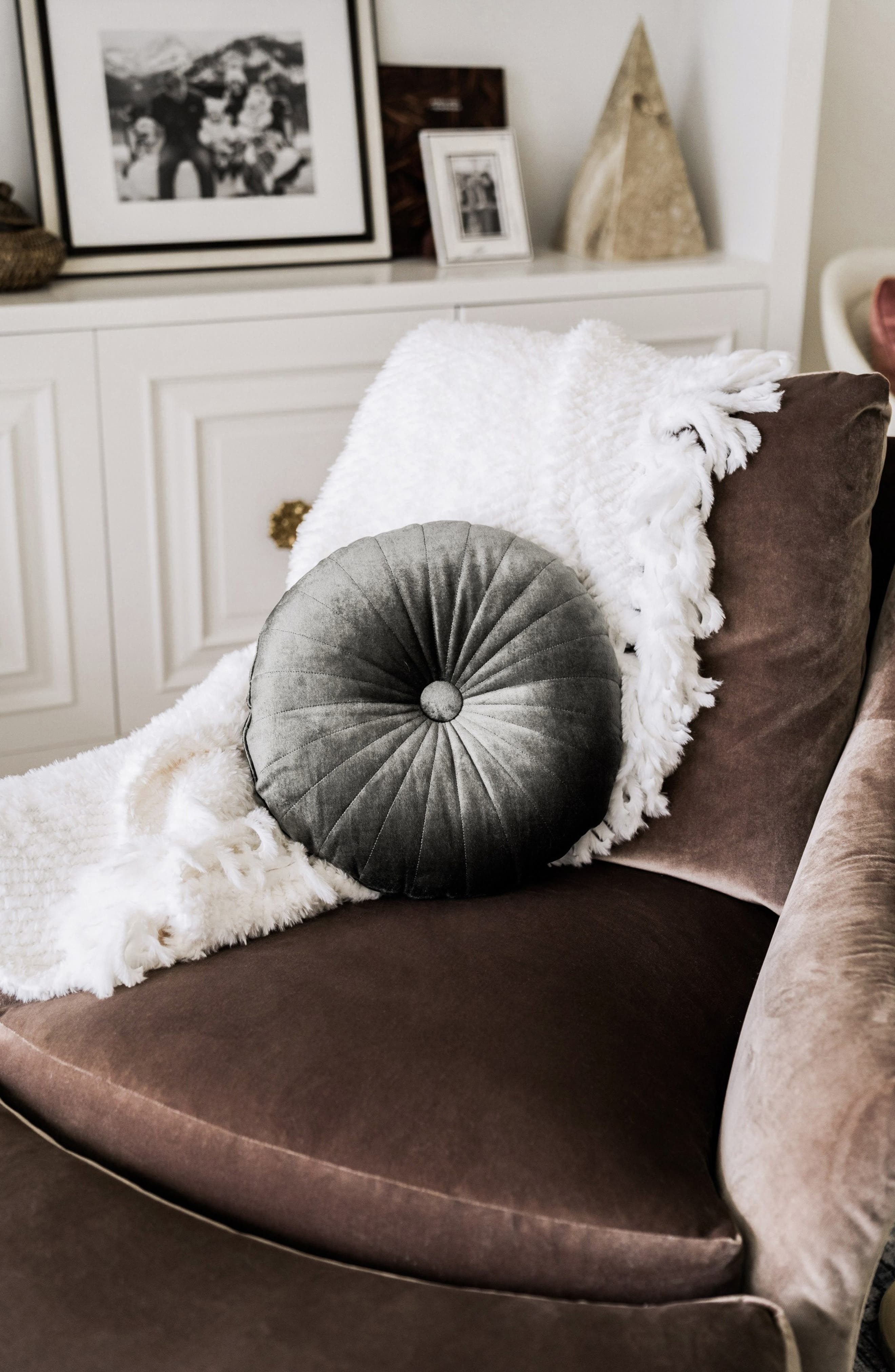 olive colored round accent pillow with tufts