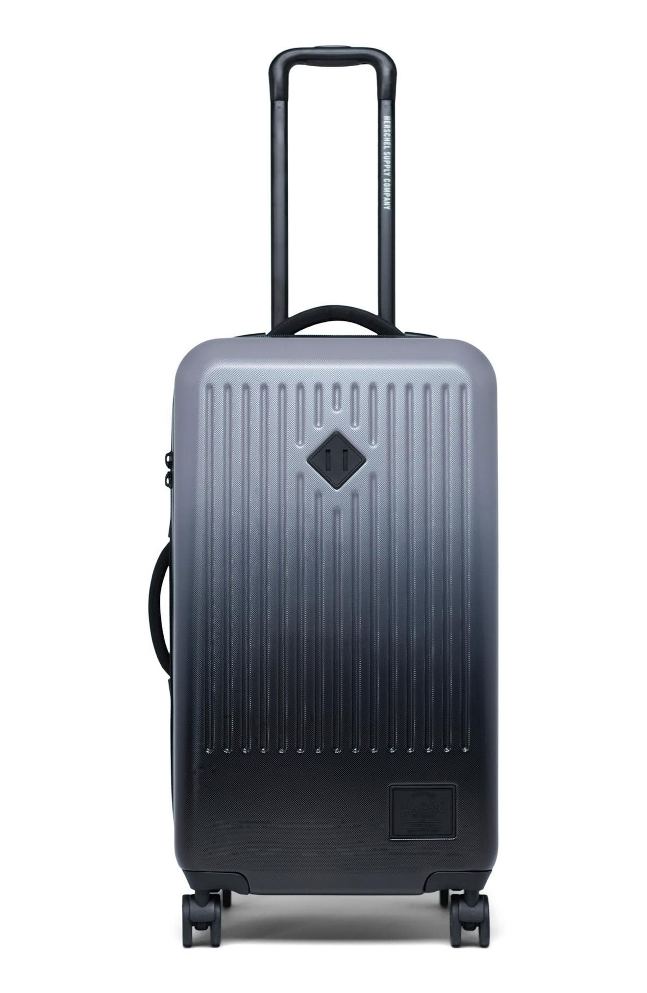ombre blue luggage with a hard-shelled case