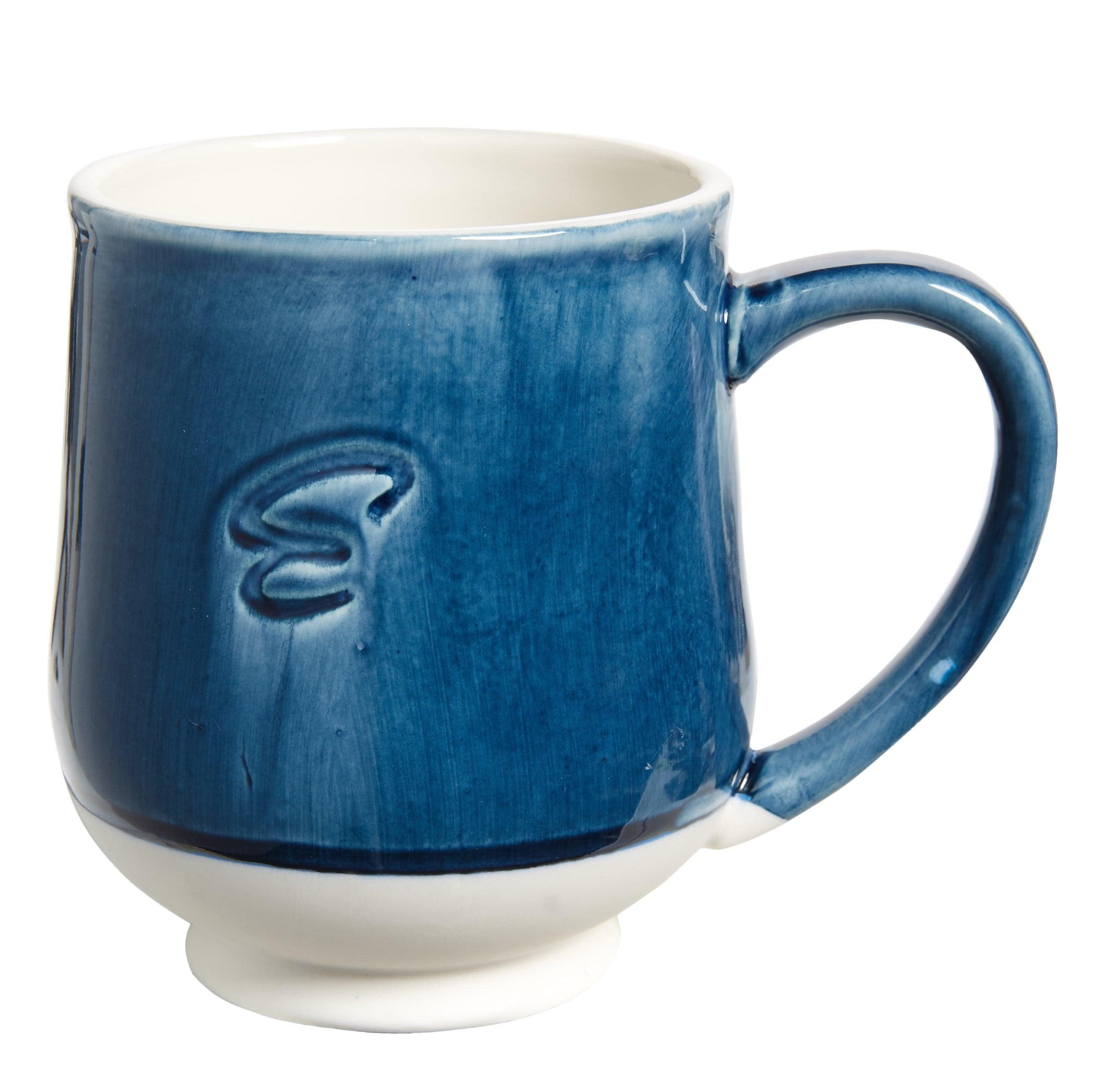 blue monogrammed mug with a glaze over it