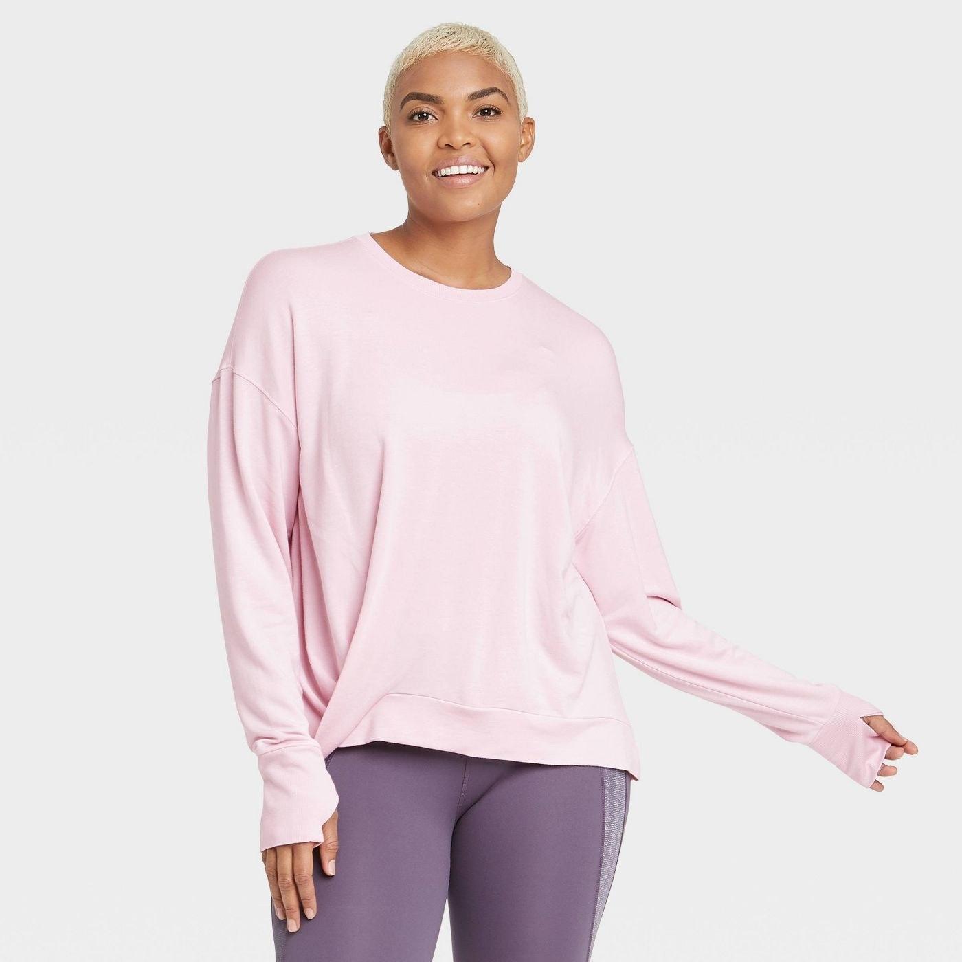 model in pink top