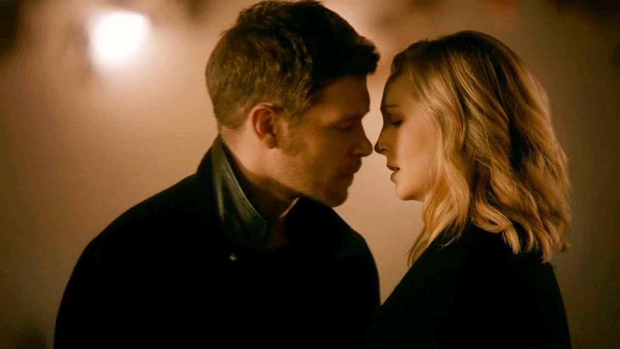Klaus and Caroline about to kiss.