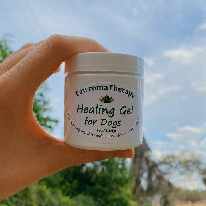 person holding jar of pet healing gel