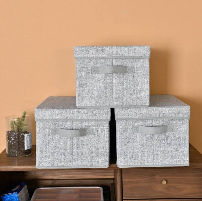 The set of three fabric baskets in gray