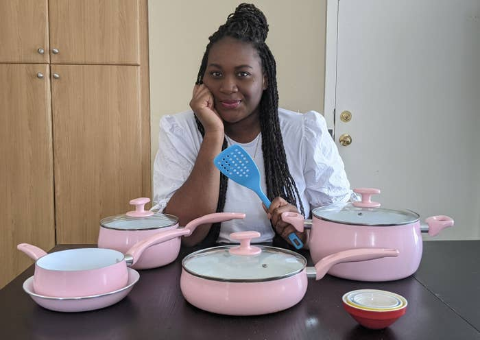 Kaysey sitting with her set of pink Tasty cookware