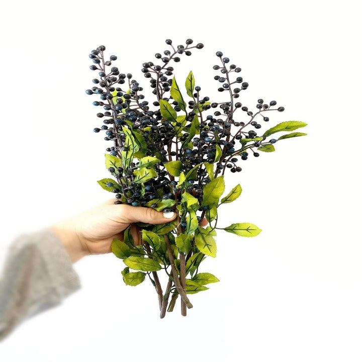 A set of faux berry stalks