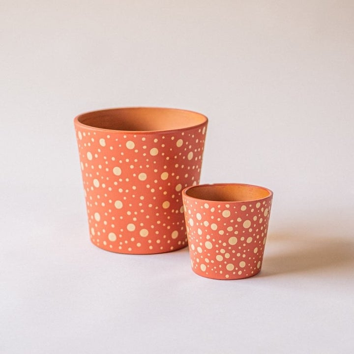 A yellow polka dot pattered pot