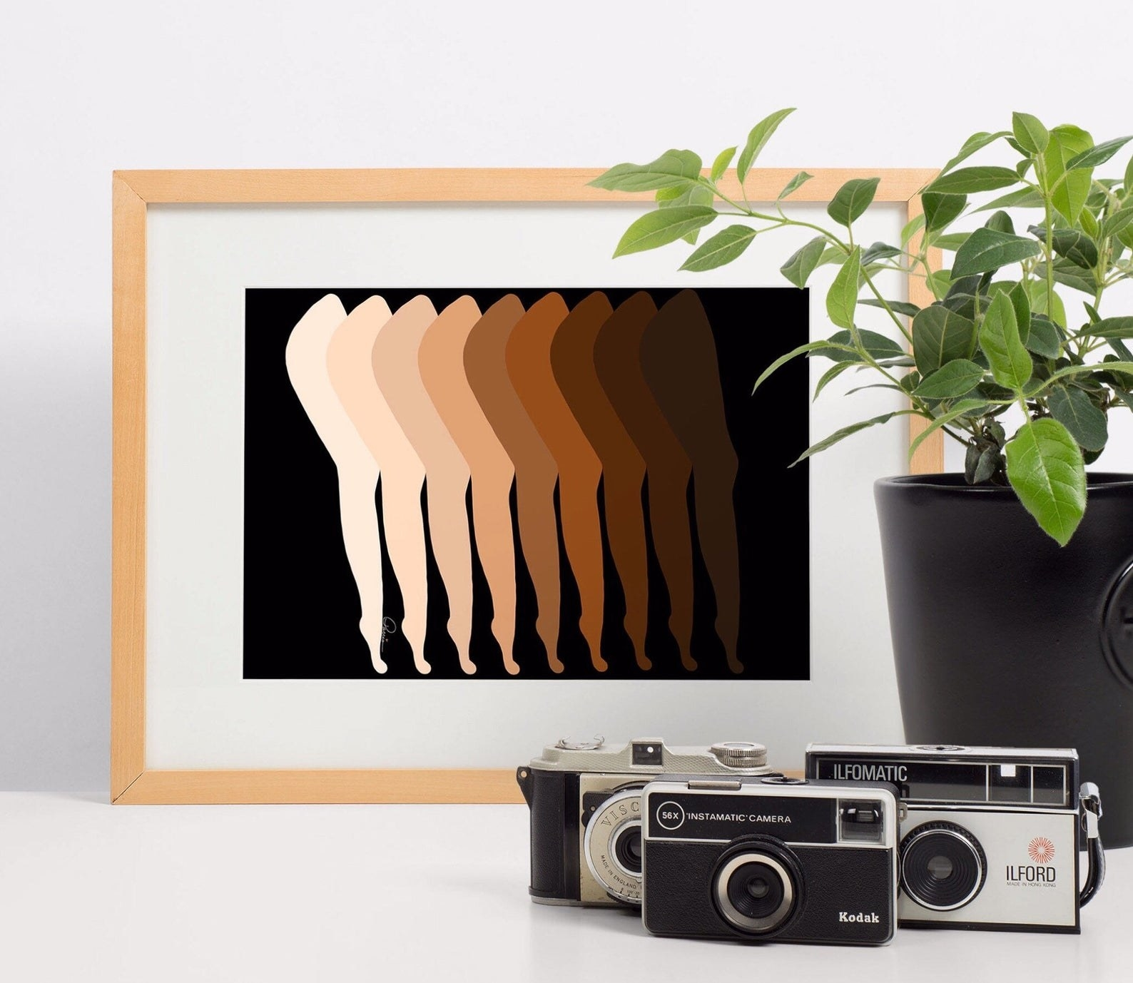 A minimalist drawing of legs layered over each other in different skin tones