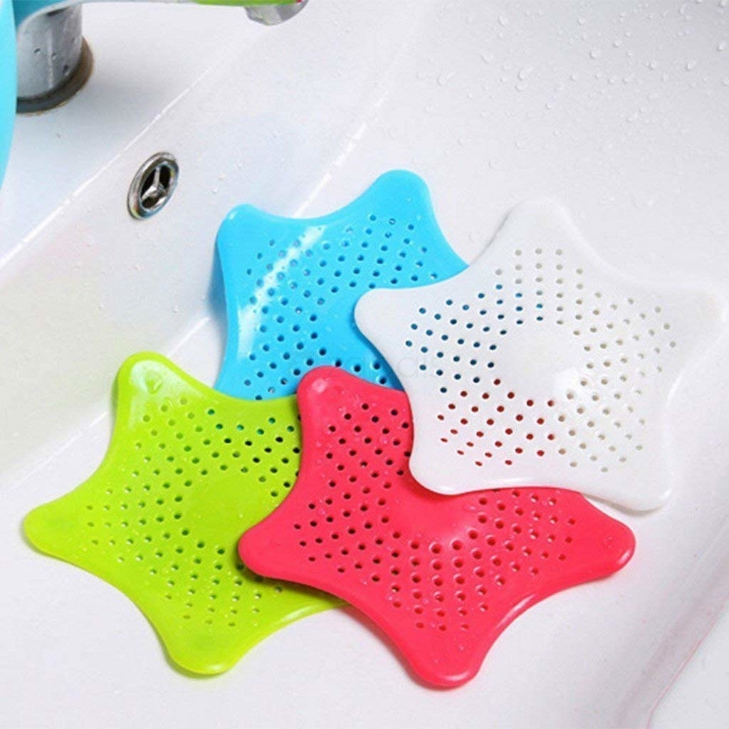 Star-shaped silicone drain catcher with small holes to release water but not small particles.
