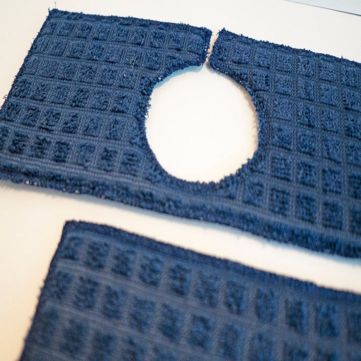 Closeup photo of sink drip guard in navy blue