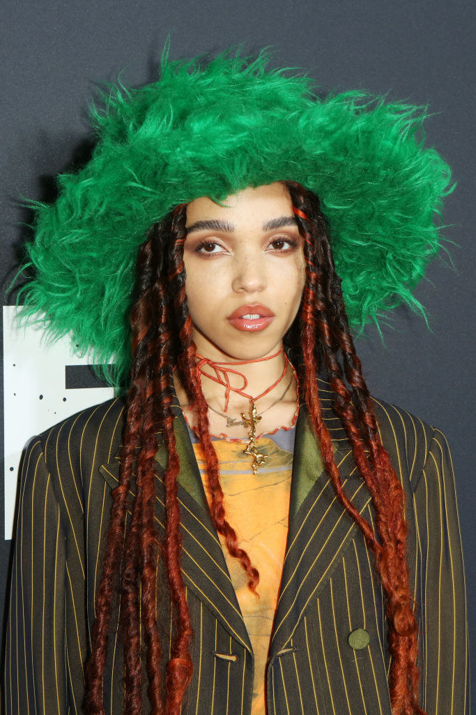 FKA Twigs wearing an oversized blazer and a furry wide-brimmed hat