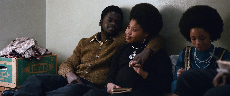 Daniel Kaluuya as Fred Hampton puts his arm around Dominique Fishback as Deborah Johnson