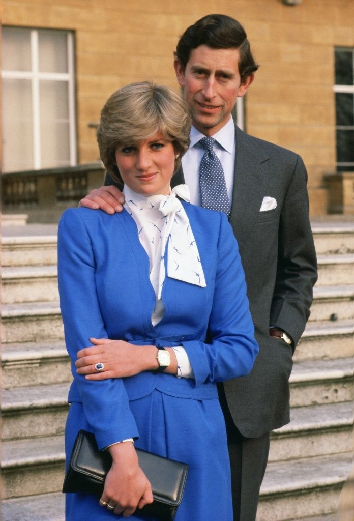 Diana wears a matching jacket and skirt the color of the sapphire in her engagement ring