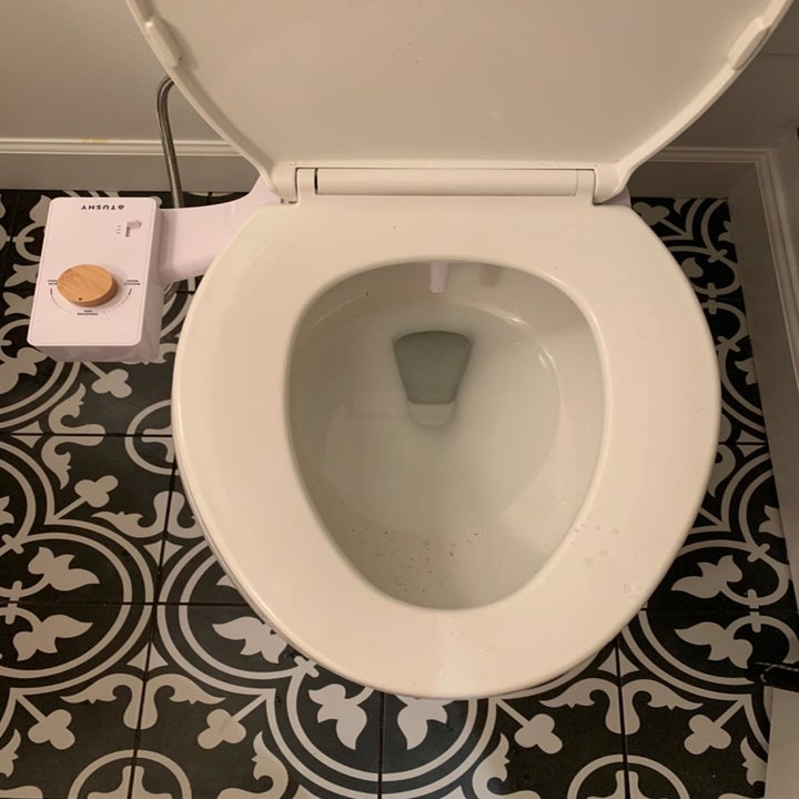 The bidet attachment with in bamboo with the seat down