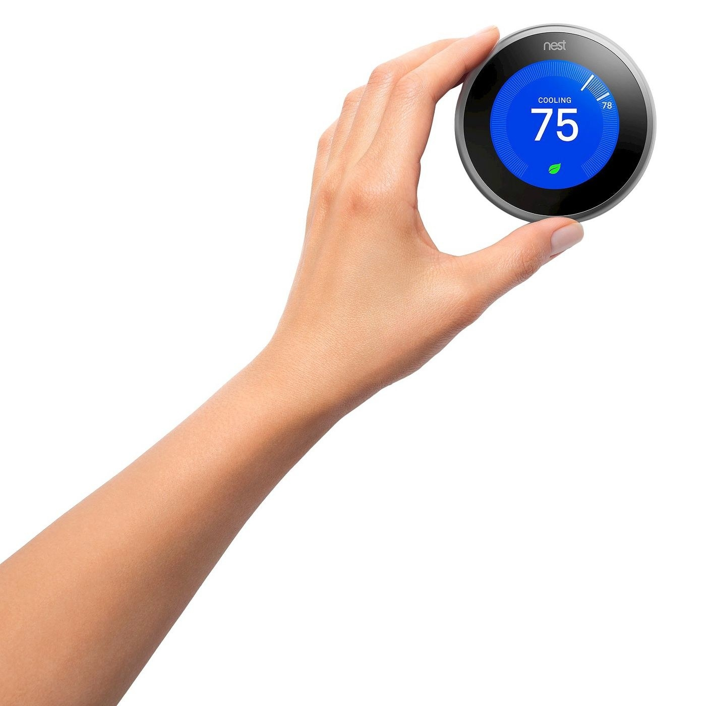 A person adjusts the thermostat