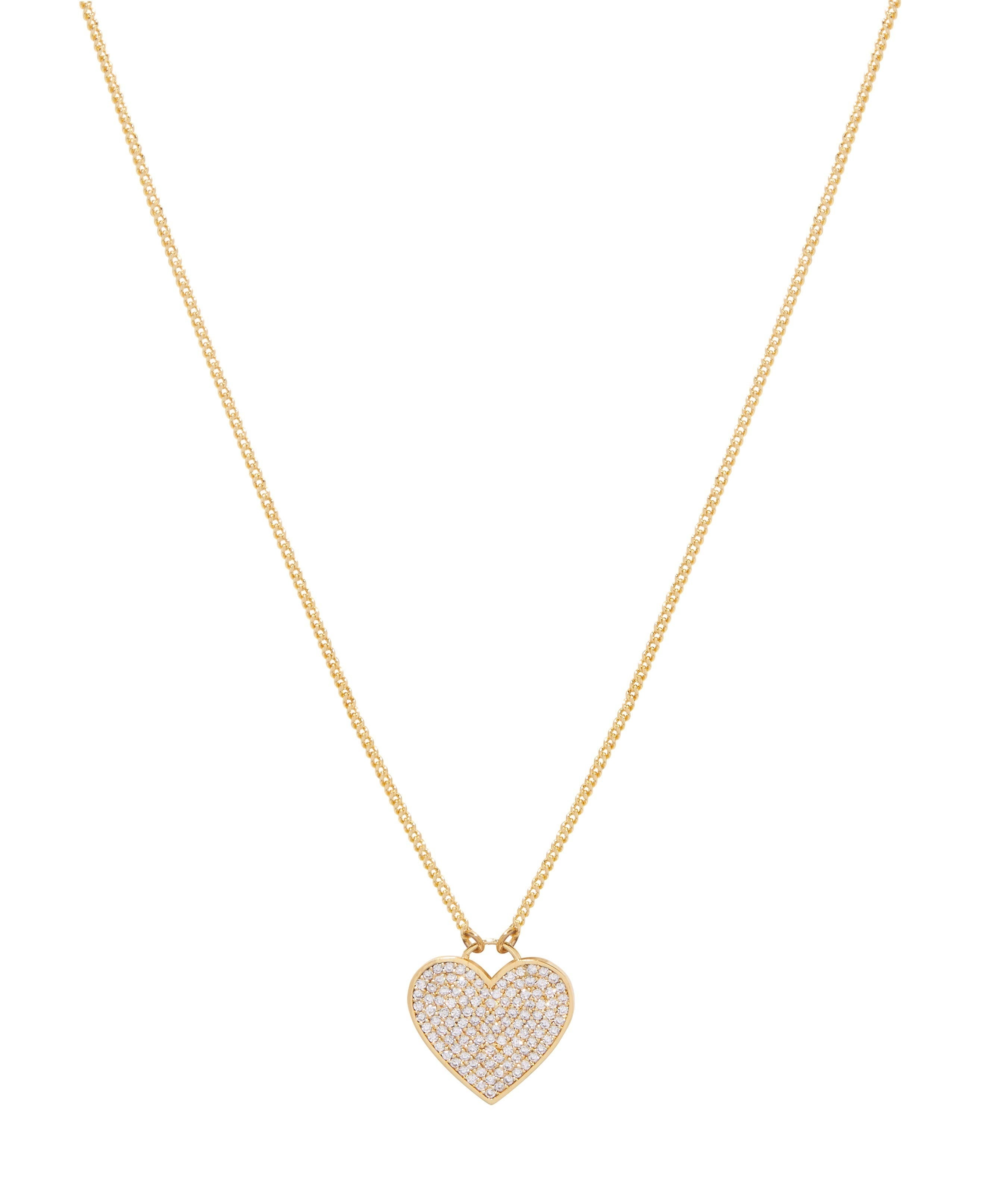 gold necklace with a shimmery heart pendant on the bottom