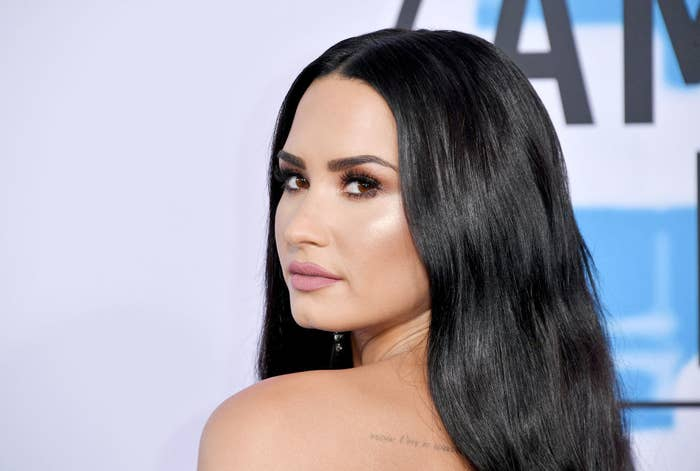 Demi Lovato posing by looking over her shoulder