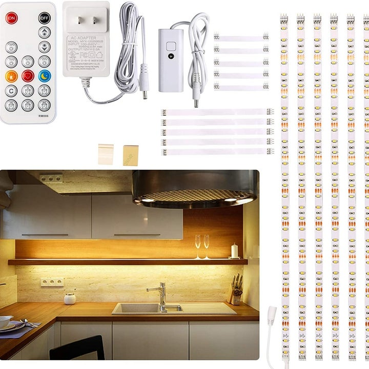 the lighting kit with an adapter, remote control, and LED light bars, in a kitchen with wood cabinets