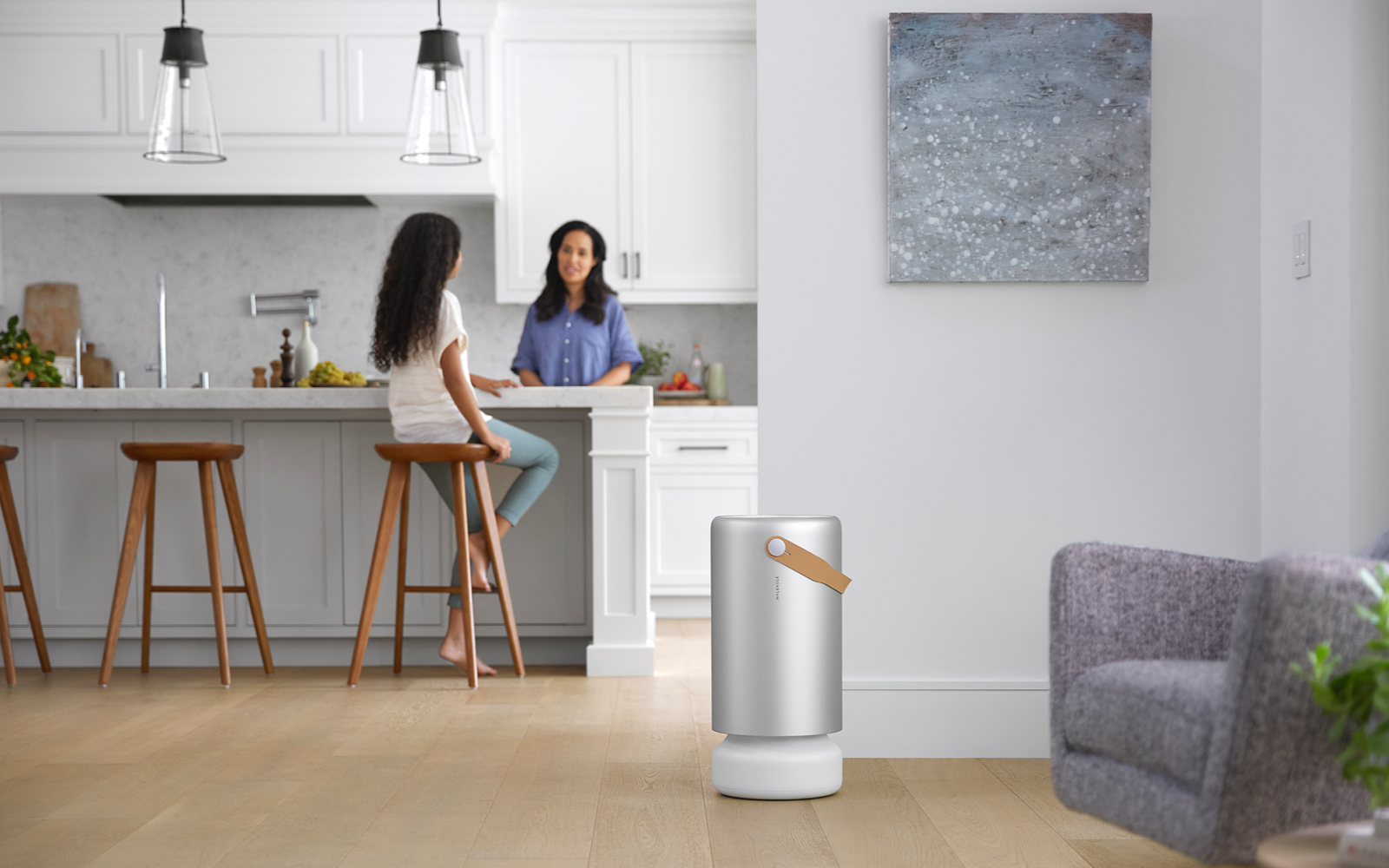 The cylindrical Molekule air purifier in a room