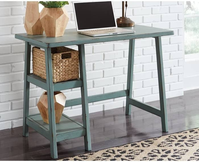 the teal signature design home office desk with the hyacinth basket on a shelf