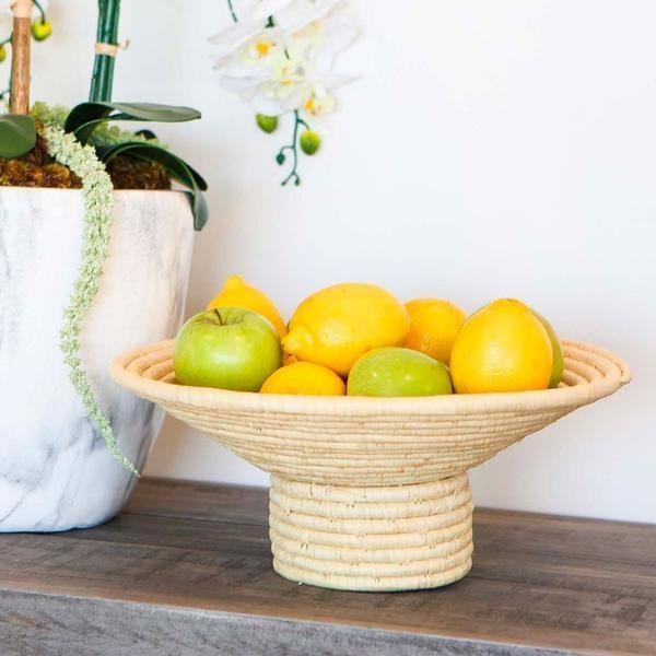 woven pedestal footed bowl with green apples and lemons