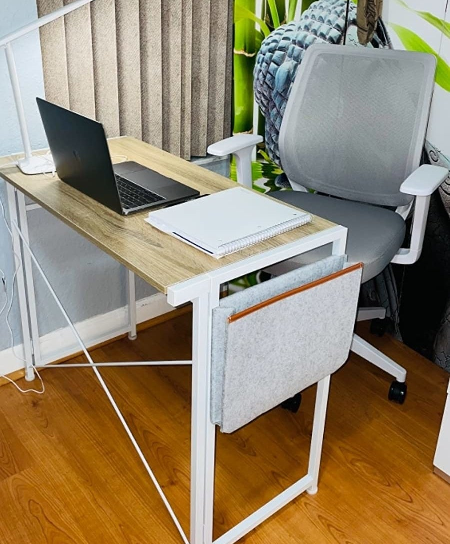 reviewer image of the jsb folding computer desk with cloth bag in an office