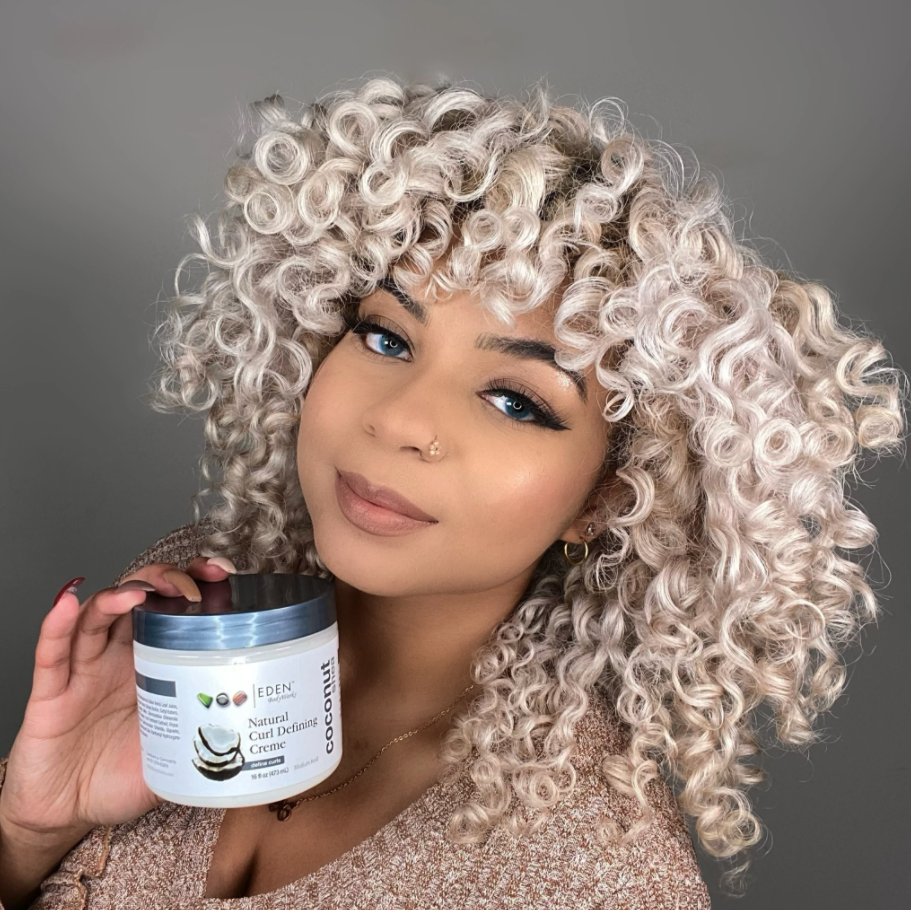 A model holding the jar of product