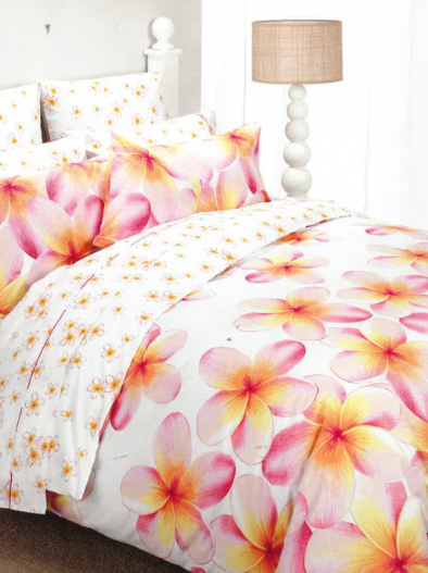 Colourful bedspread featuring large frangipanis with smaller ones on the sheets
