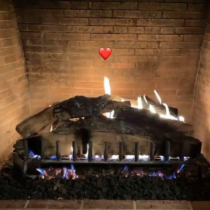 A fireplace taken from Travis and Kourtney's Instagram story